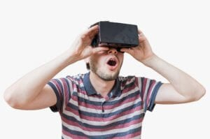 Man is wearing 3D virtual reality headset and is fascinated. Isolated on white background.